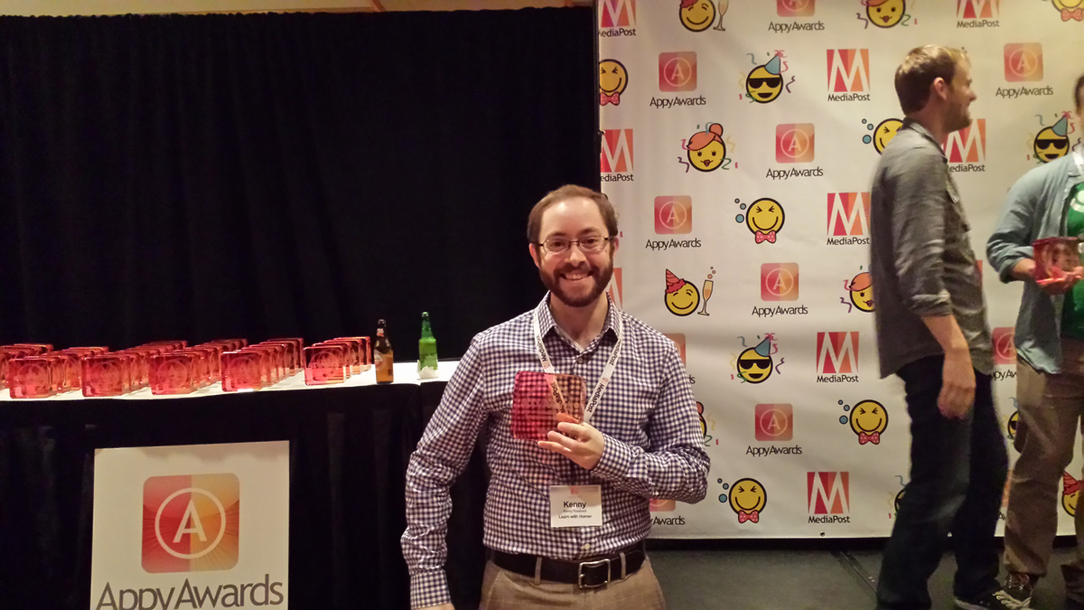 Kenneth Roraback accepting an Appy Award for Best Educational Game.